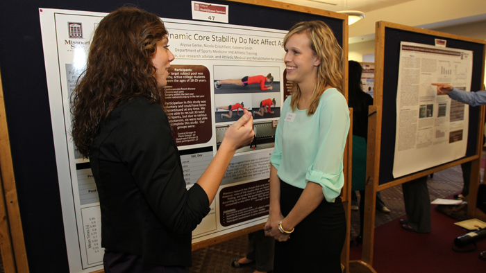 Two students talking at the Graduate Interdisciplinary Forum